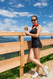 Woman with beer. Beautiful young woman with beer in alps mountain royalty free stock photos