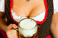 Woman with beer on décolleté in Bavaria