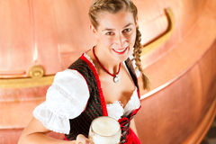 Woman with beer glass in brewery Royalty Free Stock Photo
