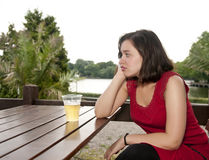 Woman with beer. Thoughtful young woman with beer royalty free stock photos
