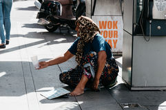 Woman beggar asking for money Royalty Free Stock Photography