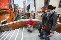 Woman begging for money in Venice Stock Image