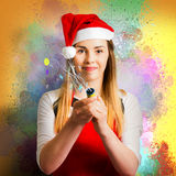 Woman beginning the new year with a bang Royalty Free Stock Photography