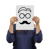 Woman behind banner male face drawn isolated royalty free stock photo