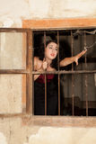 Woman behind bars Royalty Free Stock Photos