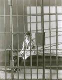 Woman behind bars Royalty Free Stock Photography
