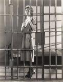 Woman behind bars royalty free stock images
