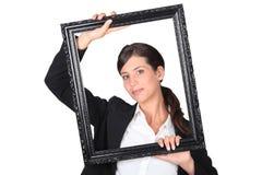 Woman behind black frame Royalty Free Stock Photo