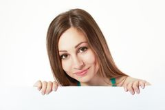 Woman behind board Stock Photo
