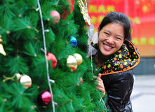 Woman behind christmas tree Stock Images