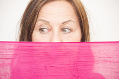 Woman behind cloth with sad view Stock Images