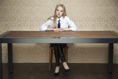Woman behind the desk Royalty Free Stock Photo
