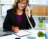 The woman behind the desk in the Office Royalty Free Stock Photography