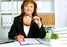 The woman behind the desk in the Office.  royalty free stock photo