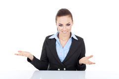 Woman behind desk welcoming Stock Image