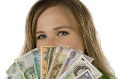 Woman behind different currencies Stock Photography