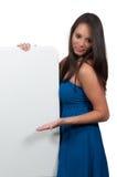 Woman behind a display Stock Photos