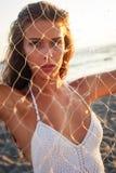 Woman behind driftnet Royalty Free Stock Photo