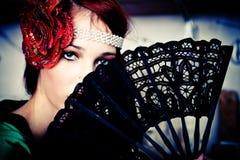 woman behind fan Stock Photo