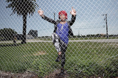 Woman behind the fence Stock Images