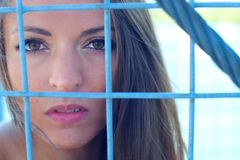 Woman rights defence locked fence in cage portrait Royalty Free Stock Images