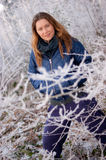 Woman behind frosty twigs Royalty Free Stock Images