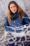 Woman behind frosty twigs Stock Photos