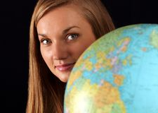 Woman behind globe Stock Photo