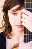 Woman Behind Guitar Fretboard Stock Images