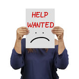 Woman behind help wanted banner royalty free stock image