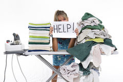 Woman behind an ironing board asks for help Royalty Free Stock Photo