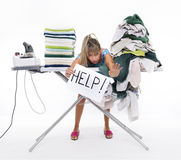 Woman behind an ironing board asks for help Stock Photo