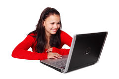 Woman behind laptop. Young woman browsing on internet isolated on white background Stock Photo