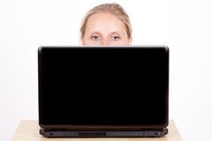 Woman behind laptop Stock Photography