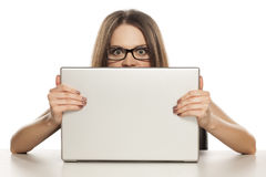 Woman behind a laptop Stock Photo