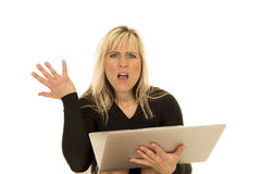 Woman behind laptop hand up mouth open Royalty Free Stock Photo