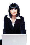Woman behind laptop marveling Royalty Free Stock Photos