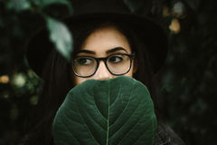 Woman behind leaf