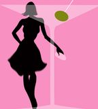 Woman behind martini glass with olive. Woman in black silhouette behind martini glass with green olive on pink background Royalty Free Stock Photo