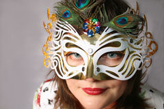 Woman Behind the Mask Stock Images