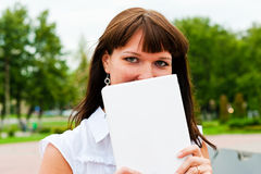 The woman behind the netbook. Female hid behind the netbook Royalty Free Stock Photography