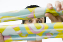 Woman behind paper Stock Images