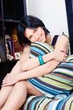 Woman behind pillow at home. Cute black hair woman behind pillow at home Royalty Free Stock Photo