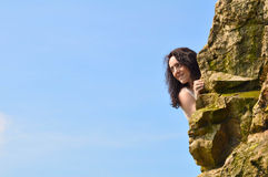 Woman behind rocks Royalty Free Stock Photos