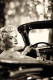 Woman behind steering wheel Royalty Free Stock Photography