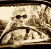 Woman behind steering wheel Royalty Free Stock Photos