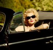 Woman behind steering wheel Stock Photography