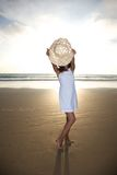 Woman behind straw hat Royalty Free Stock Photo
