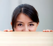 Woman behind a table Stock Photo