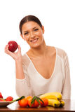 Woman behind the table full of fresh healthy fruit. Royalty Free Stock Image